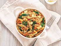 Mustard Seed Tomato Curry Fusilli with Leafy Greens and Queso Fresco